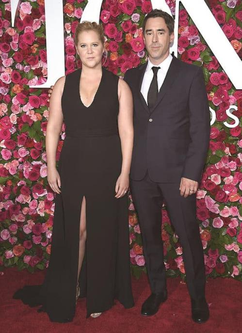 Amy Schumer y Chris Fischer.